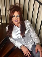 Bad girl rock chick (Sissy kaylah) Tags: bighair redhead heavymakeup satin satinblouse whiteblouse shinyblouse blouse shinyleggings leggings purplelips purplenails transvestite tranny crossdresser crossdressing
