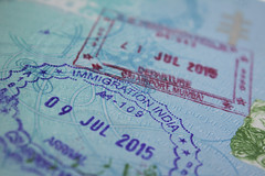Back and Forth (tiki.thing) Tags: macromonday macro blue stamp india souvenir travel purple red passport holiday ink airport