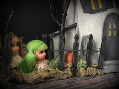 5. Hiding behind the fence (Foxy Belle) Tags: doll halloween kiddle haunted house diorama miniature putz paper cardboard diy mod 1960s tiny apple blossom cologne green hair lou locket liddle