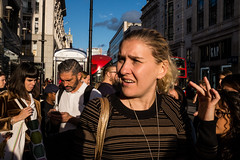 Flick of the hand (Gary Kinsman) Tags: fujix100t fujifilmx100t london w1 oxfordstreet oxfordcircus 2017 westend candid streetphotography goldenhour shopping shoppers consumerism flick hand flickofthehand crowd crowded people person