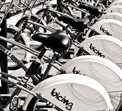 Nine Million Bicycles (Helena de Riquer) Tags: bicycles bicicletas bicicletes bicyclette bikes bike cycling bicing barcelona barcelone catalunya cataluña catalonia catalogne carrer calle street rue bn bw blackwhite vélo bicicletta fahrrad fiets urban city carré bcn blackandwhite monochrome blancinegre blancoynegro blancetnoir pov ninemillionbicycles interestingness katiemelua flickr topf25 helenaderiquer topf50 topf75 topf100 100faves sony sonydsch20 carlzeiss europa europe