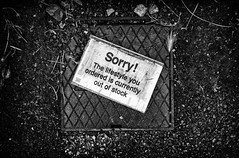 sorry! (Daz Smith) Tags: dazsmith fujixt20 fuji xt20 andwhite bath city streetphotography people candid portrait citylife thecity urban streets uk monochrome blancoynegro blackandwhite mono sign sorry lifestyle drain