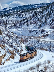 Winter in Price Canyon (rolfstumpf) Tags: usa utah pricecanyon unionpacific up up4426 trains valley canyon snow winter shadows road highway railway railroad emd sd70m