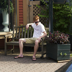 094A0918 v2 (Wheels Down) Tags: provincetown ptown streetphotography twink cute sitting flowers bench flipflops legs feet shorts shades sunglasses ginger redhead candid