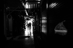 Chatuchak (lorenzoviolone) Tags: finepix flowers fujix100s fujifilm fujifilmx100s rnifilms x100s chatuchak chatuchakmarket darkness ilforddelta800 light market mirrorless shutters strangers streetphoto streetphotobw streetphotography travel:southeastasia=2017 vendors walking bangkok krungthepmahanakhon thailand flickr:explore=true fav10 fav25 fav50 fav100
