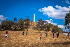 As I climbed toward cristo blanco (white christ) there were dozens of kids flying kites in the field.