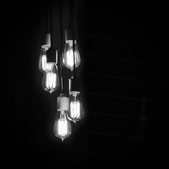 Lights in the Darkness (tim.perdue) Tags: lights darkness edison bulb incandescent filament glow hanging chandelier fixture five black white bw monochrome dark night square instagram illuminated bar meadery short north columbus oho brothers drake minimalism negative space lamp