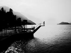 Should I jump (René Mollet) Tags: jump summer autumn divingplatform bellagio chance lake lakefront lakeside lakecomo street streetphotography silhouette streetart streetphotographiebw sunrise sunset sunny renémollet