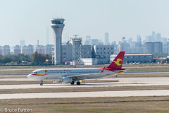 171030 TSN-NGO-02.jpg (Bruce Batten) Tags: shadows locations aircraft tsn trips occasions airports subjects transportationinfrastructure buildings tianjin vehicles businessresearchtrips china airplanes tianjinshi cn