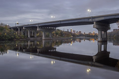 The Dartmouth Bridge and Downtown Minneapolis (Sam Wagner Photography) Tags: dartmouth i94 minneapolis bridge mighty mississippi river late twilight fall autumn dreary cold season change cityscape architecture reflections calm long exposure water midwest minnesota capturemn skyline downtown cloudy evening