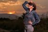 Sunset Cowgirl (Daniel Medley) Tags: portrait sunset cowgirl woman cowboy hat country landscape yongnuo yn560iii nikon d750 50mm18g off camera flash strobist idaho weiser