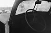 untitled-108-Edit (dvlmnkillatron) Tags: olympus om2n selfdeveloped 35mm analog film bw steeringwheel windshield