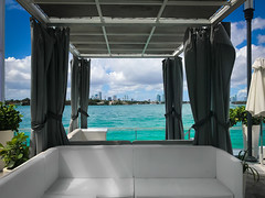 Everybody knows a little place like Kokomo (Tazmanic) Tags: miami miamibeach florida water biscaynebay clouds tropicalscene cloudscape sofa outdoorfurniture iphone