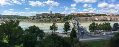 Budapest panorama (Marian Pollock) Tags: hungary budapest buda danube pest mountains bridge castle castlehill architecture river city church clouds duna var riverbank cars traffic ship hill redroofs roads foreshore daytime lanchid chainbridge panorama