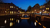Amsterdam. (alamsterdam) Tags: amsterdam bridges night longexposure reflections architecture people
