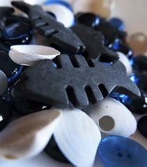 Zodiac (Espykrelle) Tags: macromondays pisces macro explore fish shells blue bleu poissons coquillages noir black hmm 7dwf closeup zodiac theme boutons buttons