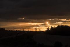 Sunset over England (mystero233) Tags: sunset sun england yellow orange uk britain gb wind turbines electricity clouds cars road landscape outdoor cambridgeshire