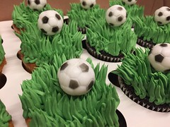 """""""Grass"""" Style Frosting Cupcakes:Grass Tip style frosting is $0.50 additionaLPlastic Soccer Ball topper is $0.50 additional"""