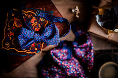 Bowtie and old wood. (jakub.sulima) Tags: nikon d750 nikkor 50mm f18g studio closeup dof depthoffield home house naturallight light flowers colours colorful wedding accessories bowtie pocketsquare cufflinks wood wooden table tabletop fashion box case casket arabic pattern arabian coffee chocolate 7dwf flickr inside indoor pretty poland red blue burple violet brown orange yellow green turquoise gold silver grey pink october autumn fall