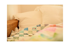 Hiding under my quilt and enjoying reading (balu51) Tags: reading patchwork sewing quilting quilt charmquilt irishchain handquilted white pink blue grey green pillow oktober 2017 copyrightbybalu51