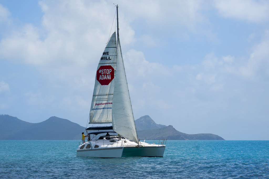 WHITSUNDAYS: #StopAdani sail ship, Whitehaven Beach_credit WASP NQ