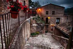Paseando por Mura (candi...) Tags: mura pueblo calle baranda macetas casa tejado tejas fachada sonya77 flores cielo farola escalera ventanas