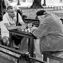 Playing cards in the park, Sofia (chrisjohnbeckett) Tags: cards playing game square recreation park sofia candid portrait monochrome bw blackandwhite bulgaria street urban city mature oldmen smoking leisure people chrisbeckett fujifilmx100f