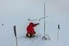 Measuring the Snow Sensor Height (redfurwolf) Tags: southpole antarctica antarctic snow snowsensor ice person spt bicep dsl flag sky white outdoor nature landscape redfurwolf sony rx100m4 tape measurment