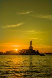 Lady liberty at sunrise