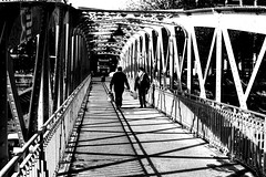 On the iron deck (pascalcolin1) Tags: paris hommes men pont bridge deck fer iron ombres shadows lumière light photoderue streetview urbanarte noiretblanc blackandwhite photopascalcolin 50mm canon play