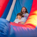 Students enjoy the inflatable slide at the Red and White Week Kickoff