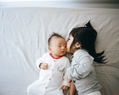 sweet moment of my two little angels (SiuDull) Tags: leicam4 angel babies infant boy baby fujian 福建 厦门 廈門 xiamen home love sister brother photography indoor light available children kid kiss morning mount thread screw memories moment sweet ginger ethan eugenie genie colour color analog portrait lsm hs1800 child kids childhood candid noritsu film 135 400 portra kodak m4 leica vintage f15 35mm m39 l39 ltm canon
