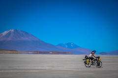 Andrew cycling across our final salar in Bolivia before entering Chile.