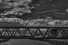 (pitjanssen) Tags: eisenbahnbrücke schwarzweis stephaniebrücke bremen weser wolken kelloggs weserpromenade