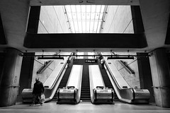Concrete Cavern (Douguerreotype) Tags: urban monochrome underground city bw uk 3 metro escalator british england tunnel blackandwhite mono subway stairs britain london symmetry architecture gb people tube steps