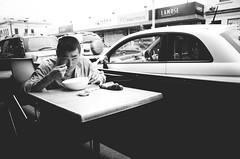 Victoria Street (JonShootsStreetPoorly) Tags: 28mm people apsc asian bw black blackandwhite bowl break eating eyes food gr humans iconic life littlevietnam lunch man melbourne melbs mono monochrome pho photography photos pointandshoot richmond ricoh ricohgr shot snap street streetphotography streetscene streetshooter streetshot streetview streets tourists travel urbanpeople urbanstreet urbanview victoriastreet vietnamese white