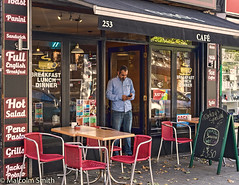 Cafe Life 14 (M C Smith) Tags: pentax k3ii man mobilephone phone seats chairs tables signs letters numbers hdr reflections board symbols red green blue pavement leaves chrome busstop