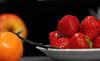 salade de fruits (vieux rêveur) Tags: fruit desaturation noir blanc couleur fraise strawberry black white color red rouge assiette plate