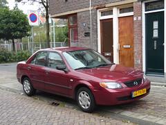 Mazda Protegé SE (2003) (brizeehenri) Tags: mazda protegé 323 2003 66prbh vlaardingen