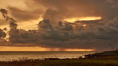Rain clouds on the coast (flowerikka) Tags: atlantic batzsurmer bretagne brittany clouds coast evening france landscape light ozean rain sky storm sunset water
