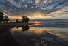Rays of Light (mclcbooks) Tags: sunrise dawn daybreak morning light clouds sun rays trees silhouettes water reflections lakechatfield chatfieldstatepark colorado landscape