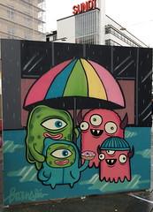 Barnslig (svennevenn) Tags: gatekunst bergen streetart barnslig monsters rain regn paraplyer umbrellas donuts doughnuts smultringer