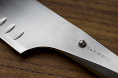 Porsche on teak (MyArtistSoul) Tags: kitchen knife modern design faporsche chroma stainless santoku hollowground onepiece stud fingerstop wood teak cuttingboard closeup 2961