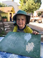 20170925_Shannon_phone_0037.jpg (Ryan and Shannon Gutenkunst) Tags: hat stmarkspreschoolandkindergarten chalkboard smile chalk batmanshirtwithcape codygutenkunst