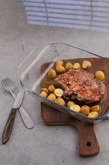 Marinated pork and potatoes in baking dish. (annick vanderschelden) Tags: raw pork cutlet marinating ingredients grounded blackpepper seasalt choppedgarlic sugarcanesugar soysauce lemonjuice sunfloweroil redwinevinegar sambal worcestershiresauce baked smallpotatoes herbesdeprovence whitekitchenboard pointofview meat marinade marination pig salt chopped sugarcane soy sauce vinegar potato peelingknife lighteffect knife belgium