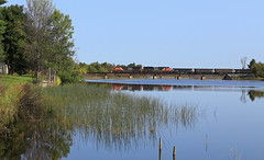 Not the house for me (GLC 392) Tags: cn canadian national railroad railway train emd sd70m2 es44ac gevo swing set manistique depot l550 2927 8856 morning light mi michigan upper peninsula rapid river tree water bridge whitefish white fish reflection life pure sub subdivision
