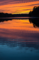 sunset (Stefano Rugolo) Tags: stefanorugolo pentax k5 smcpentaxda1855mmf3556alwr sunset magic colors layers lake water ripples sky verticalformat hälsingland sweden reflections silhouettes trees forest evening blue red yellow orange lakeside calm serene tranquillity