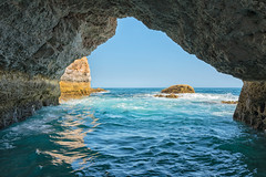 Navigating the Algarve Coast (Trouvaille Blue) Tags: portugal algarve coast grotto caves arches ocean sandstone trouvailleblue sea cave sky blue golden reflection