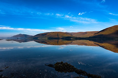 a vigil in a wilderness of mirrors (Phil-Gregory) Tags: reflections lake loch fortwilliam scotland highlands national nature nationalpark naturalphotography naturalworld natural naturephotography countryside hills mountains tokina 1116mm 1120mm 1116mmf8 1120mmf28 11mm 1120mmproatx 1120mmproatx11 116proatx 1120 water scenicsnotjustlandscapes landscapes waterscape
