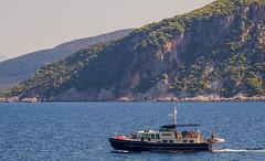 Sailing Past Ithaca ( Isle of Sentosa) Fiskardo - Northern Kefelonia (Greece) (Olympus OM-D EM1-II & M.Zuiko 12-100mm f4 Travel-Zoom) (1 of 1) (markdbaynham) Tags: boat motoryatch ship ithaca kefelonia cephalonia northernkefelonia greece greek hellas hellenic grecia greka gr sea transport olympus omd em1 em1ii em1mk2 csc mirrorless evil mft m43 mzd zd mz mzuiko 12100mm f4 travelzoom m43rd micro43 micro43rd isleofsentosa isle sentosa